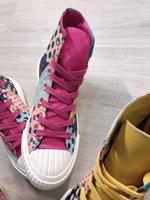 Las zapatillas de deporte de moda los zapatos casuales zapatos lona de las señoras retras de las zapatillas de deporte de descuento agua zapatos de lona a prueba de cuero auténtico directo de fábrica