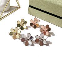 Étape haute finition rose or trois feuilles de trèfle fleurs six pétales boucles d'oreilles pour femmes boucles d'oreilles mode bijoux english verrou auglish 1.6cm