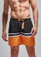 مخطط طباعة الرباط الجيب رياضة السراويل الملابس الرجال السراويل الصيف مصمم لون التباين تشغيل الملابس الرياضية فضفاض