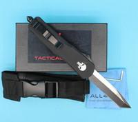 프로모션 블랙 두개골 손잡이 A07 대형 자동 전술 나이프 440C 스틸 블레이드 야외 생존 칼 나일론 가방