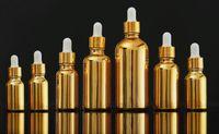 Flacon compte-gouttes en verre doré bouteille 10ml 15ml 20ml 30ml 50ml pour huile essentielle de parfum e impression liquide log0