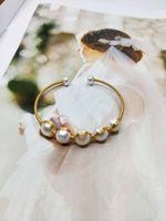 أزياء اللؤلؤ والمجوهرات اللؤلؤ الطبيعي الذهب 14K شغل أساور للنساء 8MM اللؤلؤ زر يدويا نهاية مفتوحة