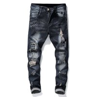 Mens Rivet Patch Robin Jeans Loch zerrissen Stretch Denim Hosen Brief Muster Stickerei dünne Hip Hop Rock Hosen für Männer 29-38