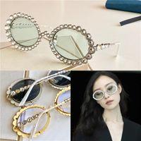 Diseño de mujeres Gafas de sol 0620 con incrustaciones con diamante de cristal espumoso Pequeño marco ovalado de calidad superior UV400 Gafas de moda Gafas de sol
