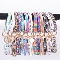 Tassel Pulseiras Keychain PU Leather Leopard Sunflower Floral Pulseira Wristlet Rodada Partido Anel chave Bangle OOA8034 Favor