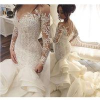 Saudí árabes vestidos de boda de la sirena del cordón con las mangas completo 2020 Botón Vestidos de novia Dubai Tren real de las colmenas de Robe de mariée