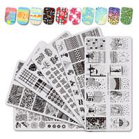 Großhandel 6 STÜCKE Stanzen für Nägel Regen Tier Bild Nail Stamping Platten Blume Blatt Wasser Marmor Vorlage Nagelkunstwerkzeuge