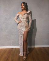 Luxury Mermaid Evening Dresses Jewel Neck Bling Sequins Beaded Long Sleeves Prom Dress High Split Ruffle Floor Length Formal Party Gown