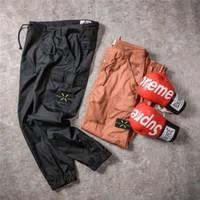 الرجال وزرة السراويل الرجعية العلامة التجارية الجديدة الرجال السفر في الهواء الطلق متعددة جيب ykk سستة مرونة حزام شارة تصميم تفاصيل مثالية السراويل