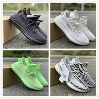 Negro Estático Refective Resplandor en la oscuridad Todos los zapatos para correr blancos Kanye West Designer Mens Women Mesh Athletic Sports Sneakers