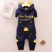 2019 Kinder Designerkleidung Sets Karikatur-Mantel mit Kapuze und Hosen Art und Weise 2pcs Brief Baby-Mädchen-Herbst-Klage-Kleinkind-Baumwollsportanzug