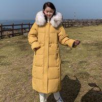 Trench femminile 2021 Giacca invernale in stile coreano Donne con cappuccio con cappuccio Faux Collar di pelliccia calda Addensare Femmina Cappotto lungo Solido 5 Colori Parka Alta Qu