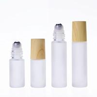 زجاج براعم زجاجات زجاجية سميكة مع غطاء الحبوب الخشب 5ML 10ML حاويات قوارير قابلة لإعادة الملء للحصول على الضروريات الزيت، والروائح، والعطور، بلسم الشفاه