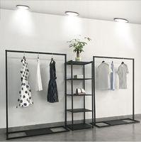 Tienda de ropa de mujer Show Show Mueble Comercial Muebles Landing Bearts Tienda La ventana está colgando un estante de tela