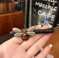Versione Fashion-coreana del nuovo copricapo Europa e negli Stati Uniti il retro in lega di api olio imitazione perla corda capelli fascia elastica goccia
