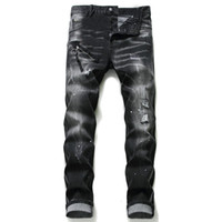 Único Mens Distressed emblema magro preta Jeans Fashion Designer Slim Fit Lavados Motocycle Denim Pants Hip Hop com painéis motociclista Calças 1057
