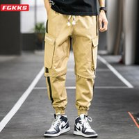 Tendencia salvaje de algodón FGKKS marca de moda pantalones ocasionales del resorte de los nuevos hombres Pantalones remiendo multi-bolsillo de los pantalones del cargo masculinos