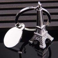 سلسلة 3D البسيطة الإبداعية برج ايفل سلسلة المفاتيح كيرينغ الموجودة في قاعدة المفتاح مفتاح سيارة جميلة قلادة حزب هدايا عيد الميلاد 30PCS / LOT شحن مجاني بالجملة