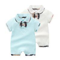 Designer Bébé Baby Babeur Boys Poule Black Cravate Coton Jumpsuits Enfant Girls Lattice Dépace à manches courtes Vêtements Vêtements Couche F5484