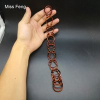 H409 / 9 anillos en forma de herradura Rompecabezas de alambre hecho a mano Solución de rompecabezas de metal de cobre rojo Juguete