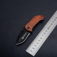 DA33 Coltello da tasca pieghevole ad apertura assistita Manico in legno 440C Lama in acciaio inossidabile Mini coltello da campeggio Portachiavi Strumenti EDC esterni