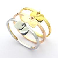 Выход фабрики высокого качества пятого поколения 18K Золото Титан Сталь Браслет Мода Классический Пара в форме сердца браслет для пар дар