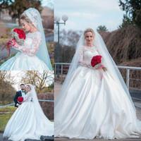 Abiti da sposa arabi Dubai Ball Gown 2020 Maniche lunghe trasparenti Appliques di pizzo Perline Abiti da sposa in raso con strascico Taglie forti