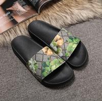 Nuevo mujeres y los hombres de moda casual del pío del dedo del pie sandalias femeninas del cuero zapatillas de diseño calza muchachos niñas chanclas zapatos con la caja