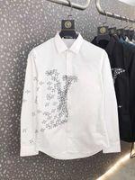 Primavera otoño nueva moda hombre diseñador camisas blanco negro fino manga larga hombre trabajo camisa casual importado paris marca ropa FWZ241