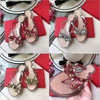 Avrupa ve Amerikan yaz yeni stil kelebek düğüm perçin terlik kadın düz kum kaygan serin terlik jöle ayakkabı kauçuk boyutu 35-41