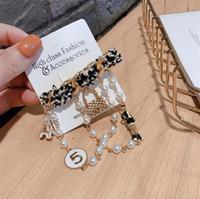 뜨거운 한국어 패션 브로치 오리지널 디자인 모직 만화 철 타워 진주 체인 5 단어 핀 버클 배지 브로치