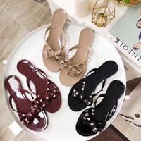 Pantofole per rivetti estivi donna classica grande fiocco bowknot infradito sexy pantofola da spiaggia femminile gelatina piatta lusso designer sandali in PVC taglia 35-41