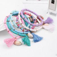 Handgemachte Harz Perlen geflochtenes Armband für Frauen Mädchen Böhmen elastische einstellbare Quaste natürliche Shell Armreif Boho trendigen Schmuck