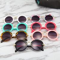 Kinder-Runde Vintage-Sonnenbrillen Jungen-Sport-Shade Mädchen-Blumen-Druck-Brillen Mode Kinder Sommer-Strand-Sunblock Zubehör TTA1159-14