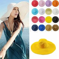 Lady Sun Straw Beach Cappello Erba Braid Cap Donne Large Floppy Fold Tesa larga Beach Cappelli Panama Chiesa 20pcs AAA2001