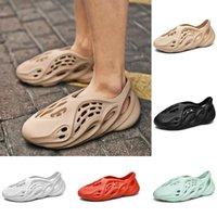 저렴한 거품 주자 서쪽 나막신 샌들 트리플 블랙 슬라이드 패션 슬리퍼 여성 망 tainers 디자이너 비치 샌들은 슬립에 카니 신발