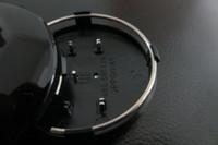 Dhl 100 قطعة / الوحدة 60 ملليمتر رمادي / أسود عجلة مركز كاب عجلة محور قبعات الحافات غطاء سيارة شارة شعار حالة ل A3 A4 A6 A8 TT، 4B0601170 التصميم