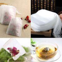 Las bolsitas de té 100pcs / paquete 5,5 x 7CM bolsas vacías perfumado té con cuerdas curan Papel Sello de filtro para la hierba de té flojo EEA137