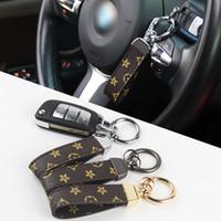 Colle de concepteur corde en cuir PU pour sacs Sangles de téléphone portable Charms Cou Cou Créatif Petite cadeau Activité de luxe Porte-clés de luxe pour BMW BENZ