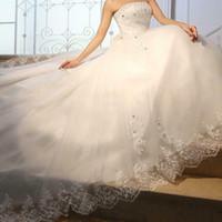 Abiti da sposa con abiti da sposa senza spalline in tulle bianco in rilievo Pietre Sashes A-Line Sweetheart Beach nuziale