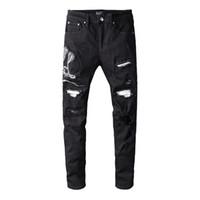 Nuovo Mens stilista dei jeans donne degli uomini di alta qualità Motociclista jeans strappati ricamo Moda Skinny Jeans denim Pantaloni