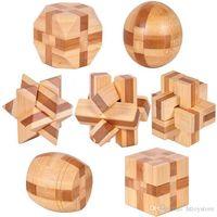 Wholesale-7pcs / lot 3D صديقة للبيئة الخيزران الذكاء اللغز دعابة الكبار لغز ، ألعاب خشبية التعليمية للأطفال