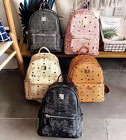 La edición de Han moda de cuero de gran capacidad Bag Lady bolsos Mochila de las mujeres femeninas del remache de los volantes Mochila paquete de moda de alta calidad