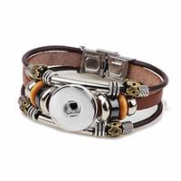 Vendita calda all'ingrosso intercambiabile 104 originale in vera pelle retro moda braccialetto 18mm con bottone a pressione gioielli fascino per le donne uomini regali