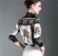 The leopard printing temperament lapel neck Women's professional long sleeved shirt cool black Blouses for summer