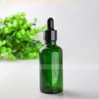 Großhandel e Flüssigkeit e Saft leeres Glas Tropfflaschen 50ml grün kosmetische Glasflaschen mit 7 Artkappen für Wahl