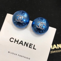 Hot sale earring blue and white half with diamond and logo d...