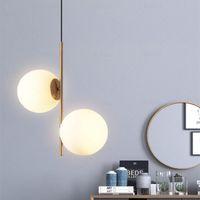 ضوء مصباح معلق الحديثة أدى الطعام غرفة نوم السرير بهو جولة زجاج الكرة الذهب الشمال بسيطة الحديثة قلادة ضوء مصباح