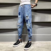 Jeans dos homens 2021 Calças de furo social líquido vermelho com a versão coreana da moda alta da rua das calças da tendência