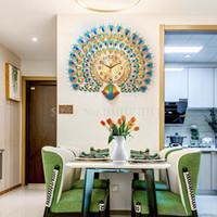 مشاهدة الجدول غرفة المعيشة ساعة الحائط شخصية الإبداعية الأزياء الطاووس شنقا الجدول الجو بسيط الساعة 21 بوصة